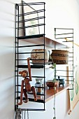 Monkey toy, copper cup and vintage containers on String shelves