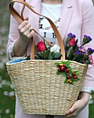 Woman holding basket of cut flowers