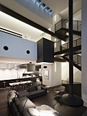 Patterns of dark and light in double-height black-and-white interior