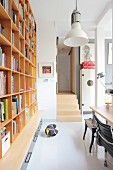 Shelving and white floor in study