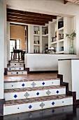 Terracotta-tiled steps in split-level house