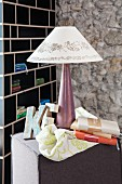 Table lamp with printed fabric lampshade, wooden decorative letter and cloth