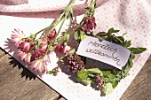 Welcome sign on small wreath of marjoram