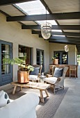 Wicker furniture on roofed terrace