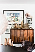 Ethnic ornaments on retro sideboard