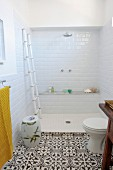 Open shower adjoining patterned tiles