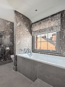 Elegant bathroom in shades of grey with floral wallpaper