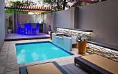 Modern courtyard with pool and illuminated bar