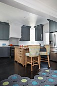 Wooden island counter in American-style kitchen