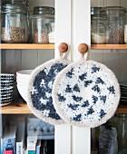 Homemade crocheted pot holders made from felting wool
