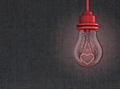 Light bulb with red heart-shaped filament in front of concrete wall - 3D rendering