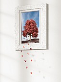 Leaves falling from tree in picture frame - 3D rendering