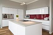 Interior of modern flat; kitchen with free-standing kitchen block
