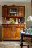 Antique, artistically carved dresser with marble top