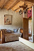 Sleigh bed and double bed in romantic bedroom