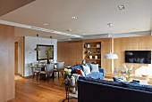 Wood-clad walls in open-plan interior