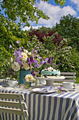 Garden table festively set in blue and white