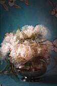 Bouquet in teapot; double exposure