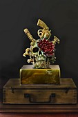 Skull and flower sculpture on top of old wooden case