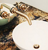 Close up of sink and bronze tap