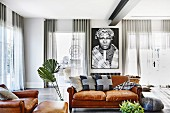 African picture in the living room with leather sofa