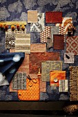 Mood board of fabrics in shades of blue and brown
