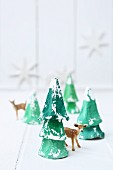 Christmas trees made from egg boxes and deer figurine