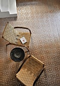 Two retro armchair with woven seats on tiled floor