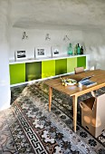 Various floor tiles in Mediterranean interior with fitted sideboard, cardboard chairs and retro ambiance
