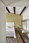 Mediterranean hotel room with traditional tiled floor in restored period building