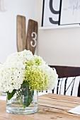 Vase of hydrangeas on wooden table