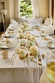 Easter table set with ostrich eggs and hens' eggs