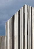 Detail of modern, wood-clad, gable-end façade