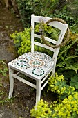 Chair with mosaic seat in garden