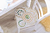 Old chair with circular mosaics on seat