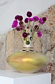 Purple dahlias in designer vase