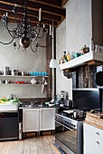 Gas cooker, sink and bracket shelves in rustic kitchen