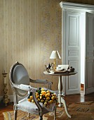 Panelled door, Baroque chair and side table in classic interior