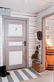 Grey and white front door in rustic Swedish house