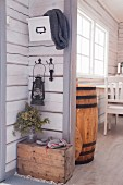 Lantern hanging above old wooden crate in hallway
