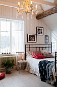 Wooden floor and wood-beamed ceiling in traditional, Scandinavian attic bedroom