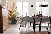 Set table, bistro chairs and Christmas tree