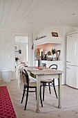 Old wooden table and bistro chairs in kitchen-dining room