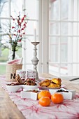 Festive snacks on table in front of window