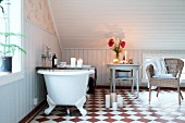 Candlelit, attic bathroom with chequered floor