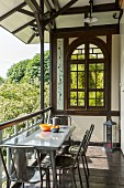 Summery loggia in half-timbered house with arched window