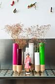 Arrangement of colourful vases and figurine of Queen Elizabeth II