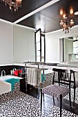 Mirrored wall in black and white retro bathroom