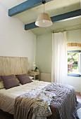 Blue ceiling beams in Mediterranean bedroom