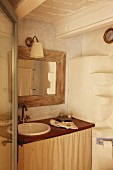 Rustic bathroom in natural shades with curtain below washstand